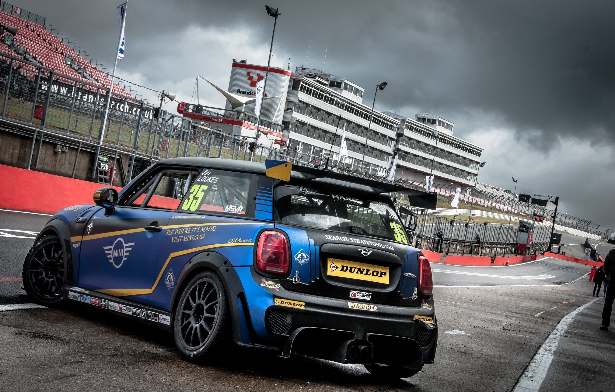 Mini on grid with cloudy background