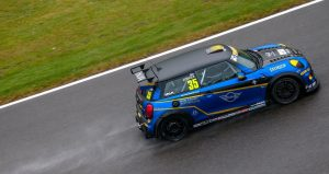side view of blue and gold mini